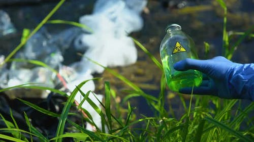 Person Pouring Biohazard Liquid in Polluted Water, Toxic Waste, Spreading Virus