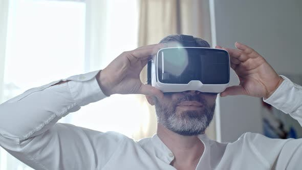 Cover Image for Bearded Man Wearing VR Goggles