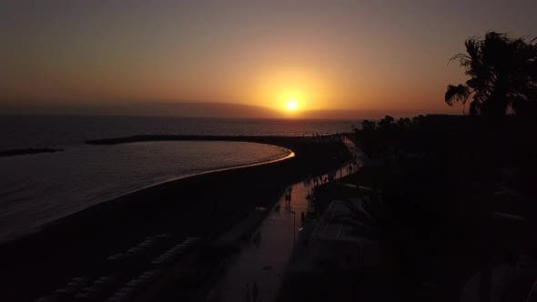 Flying Along the Promenade of Los Cristianos at Dusk Canary Islands Tenerife Spain