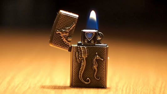 Cover Image for Burning Small Pocket Lighter On Table 1