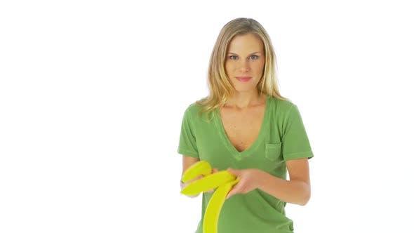 Thumbnail for Woman juggling bananas