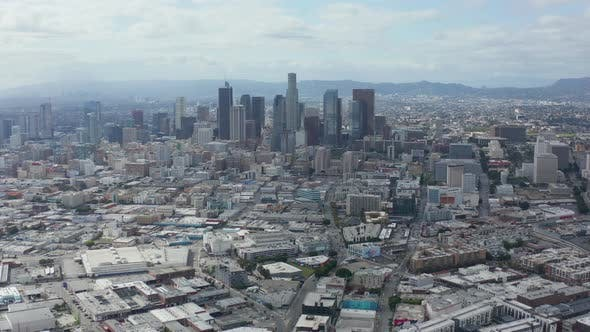 Thumbnail for AERIAL: Slowly Circling Downtown Los Angeles Skyline with Warehouse Art District in Foreground with
