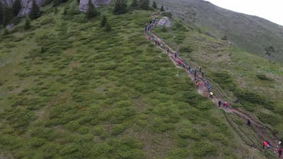 Group Of People On A Mountain Trail At High Altitude