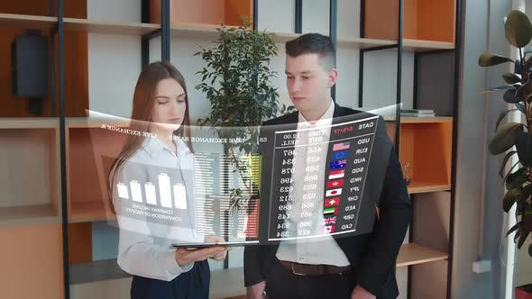 Financial Analysts Consider a Holographic Display with Information on World Currencies