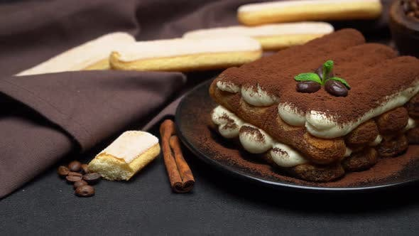 Thumbnail for Classic Tiramisu Dessert on Ceramic Plate and Savoiardi Cookies on Concrete Background