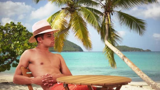 Thumbnail for Millennial Latino man on tropical vacation enjoying the sunshine on holiday