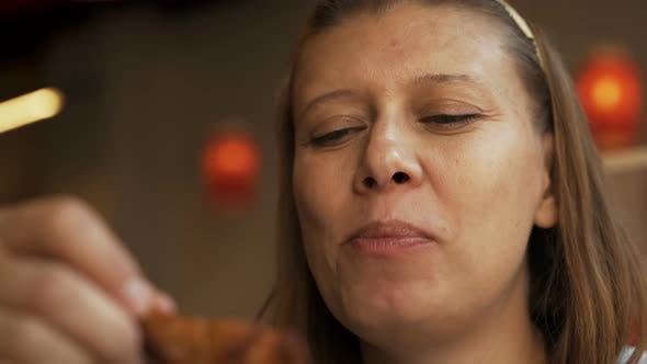 Thumbnail for Woman In Fast Food Cafe Eating Junk Food
