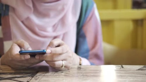 Close Up of Women Hand Holding Smart Phone