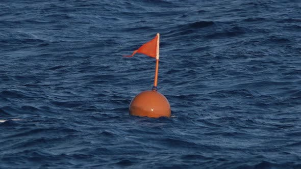 Thumbnail for Red Warning Buoy Is Submerged in the Water