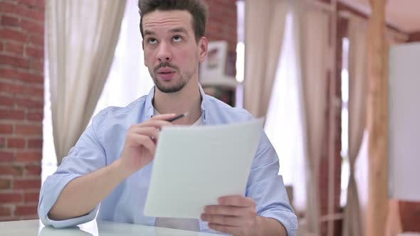 Thumbnail for Ambitious Young Man Reading the Document