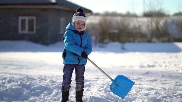 Thumbnail for Little Boy Shoveling Snow at Winter