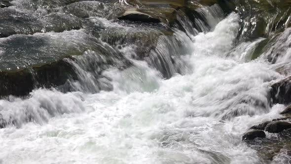 Clean Foamy Water of Mountain River Close Up