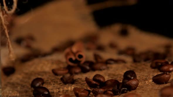 Thumbnail for Coffee Beans with Cinnamon Near the Coffee Bottle on Black Background, Rotation