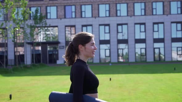 Thumbnail for Girl Goes with Mat To Fitness Class