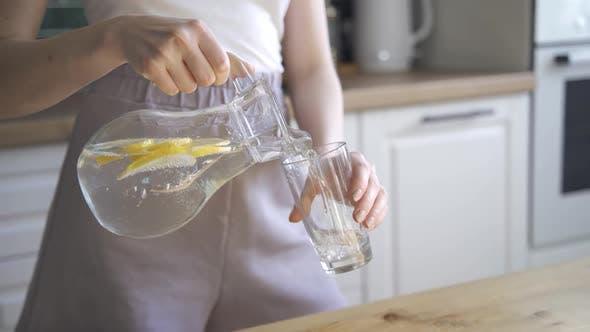 Beautiful Slim Woman Drinks Lemon Water for Detox