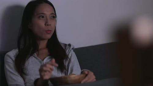 Woman watching movie at home