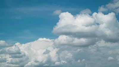 Cumulus Clouds On A Blue Sky