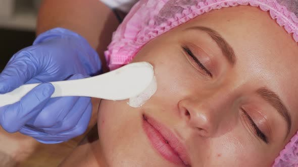 Thumbnail for Young Woman Getting Facial Treatment at Cosmetology Salon
