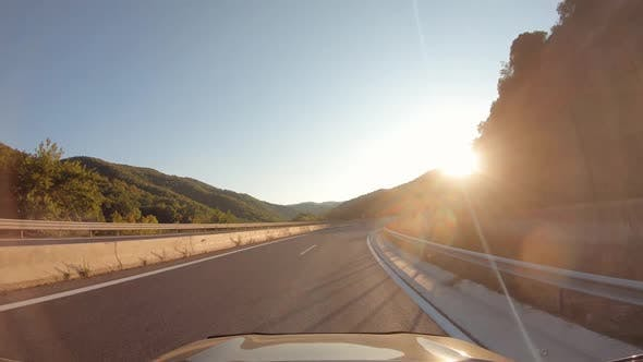 Summer Road Trip on Europe Firstperson View of a Moving Car on a Highway Hills and Mountains Natural