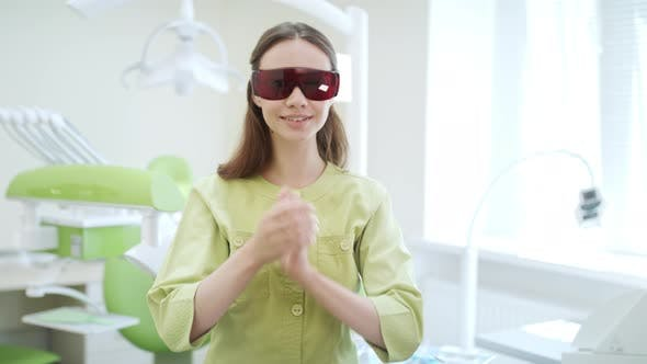 Thumbnail for Young Doctor Dressing Up Dental Protective Glasses in Dentist Office