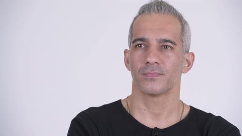 Handsome Persian Man Thinking Against White Background
