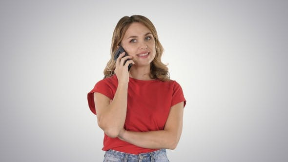 Thumbnail for Young beautiful woman in red t-shirt speaks on mobile phone
