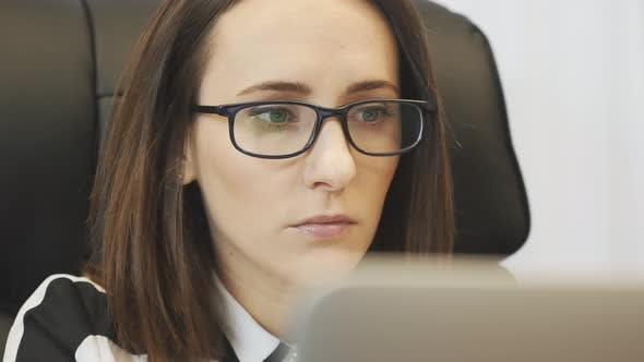 Thumbnail for Woman face looking at computer screen sitting in modern office. Business corporate concept