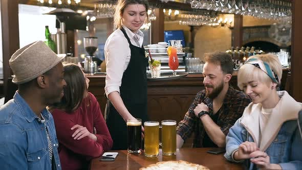 Thumbnail for Focused Young Waitress Serving Beers and Cocktails