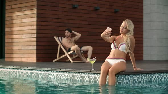 Thumbnail for Sexy Woman Taking Selfie in Pool for Instagram. Beauty Model Taking Photo