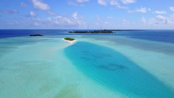 Thumbnail for Daytime aerial abstract shot of a sunshine white sandy paradise beach and blue ocean background in c