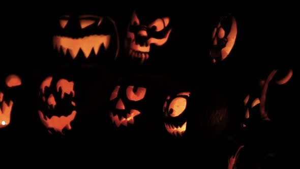 Glowing in the dark spooky Jack-o-lanterns carved from real pumpkins.