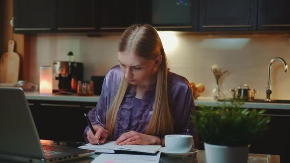 Young Business Woman Working at Home By Sitting at the Computer