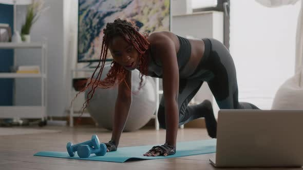 Fit Black Woman in Sportswear Doing Workout Burning Fat Calories