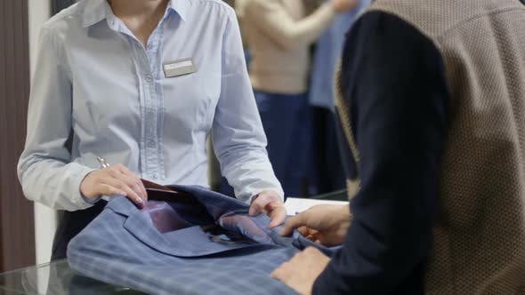 Thumbnail for Sales Assistant Helping Customer in Menswear Boutique