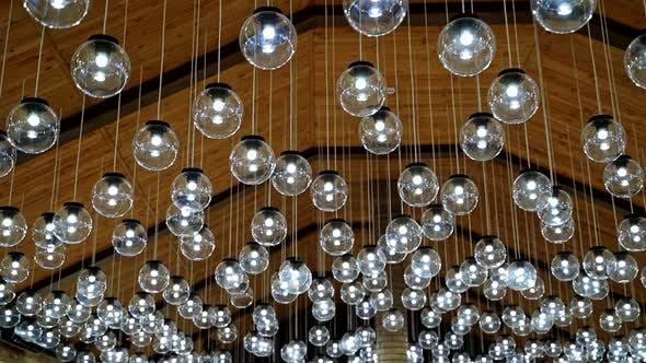 Many round light bulbs background.