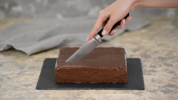 Thumbnail for Female Hand Cutting Chocolate Cake with Knife.