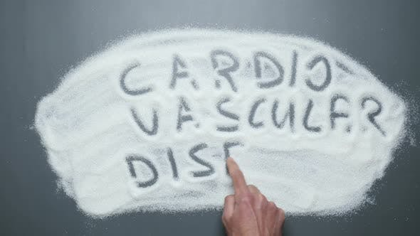 Text Cardiovascular disease written on sugar background. Sugar kills.