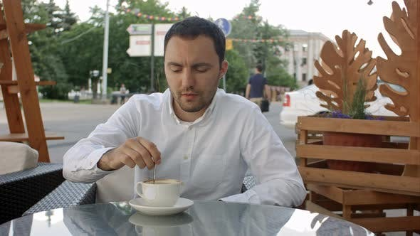 Thumbnail for Businessman Having a Cappuccino at the Bar