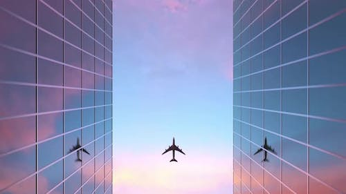 Airplane Flies Over The Glass Building