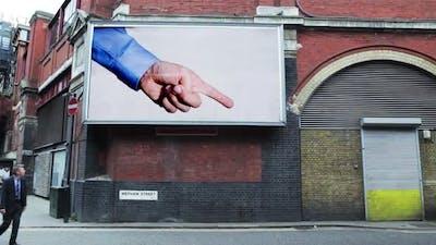 Billboard pointing at pedestrian