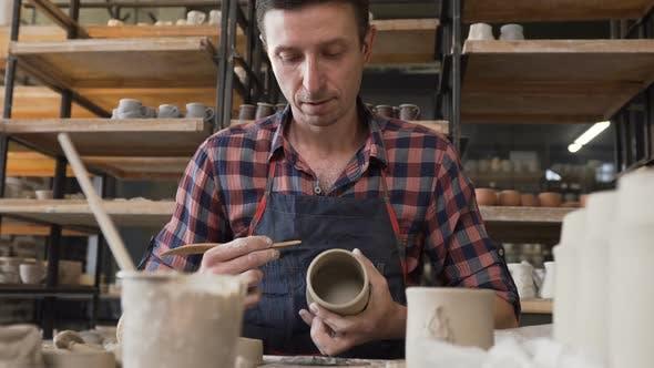Thumbnail for Caucasian Focused Man Making Ceramic Vase in the Pottery