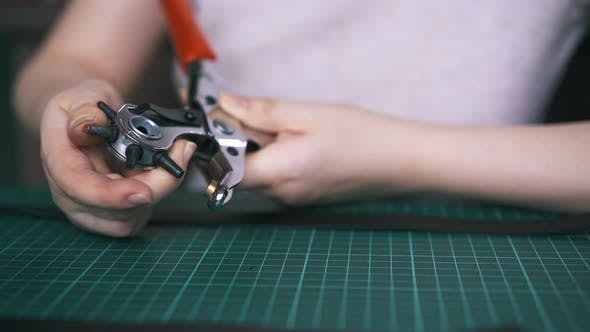 Thumbnail for Designer Rotates Hole Punch Pliers and Takes Leather Cloth
