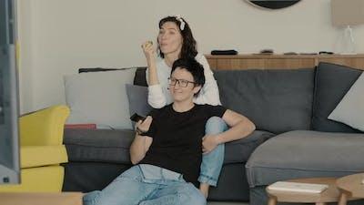 Two Women Watch Tv on Sofa Rbbro