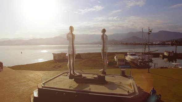 Thumbnail for Moving Statues of Man and Woman in Batumi Georgia Against Sea, Ali and Nino