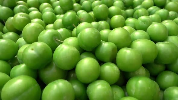Pile Of Green Plums At Produce Market
