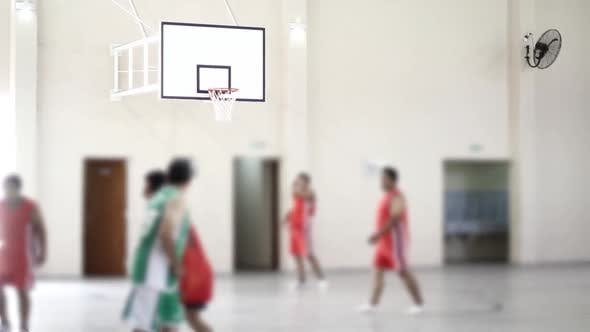 Thumbnail for Blurred Background of Basketball Players in a School.