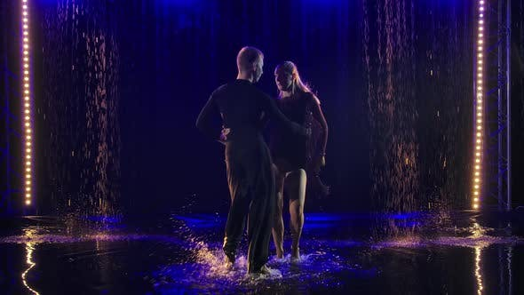 Thumbnail for A Couple of Dancers in Black Suits Dance a Quick Jive on the Surface of the Water and Create