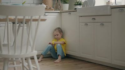 Kid using her smart watch at home