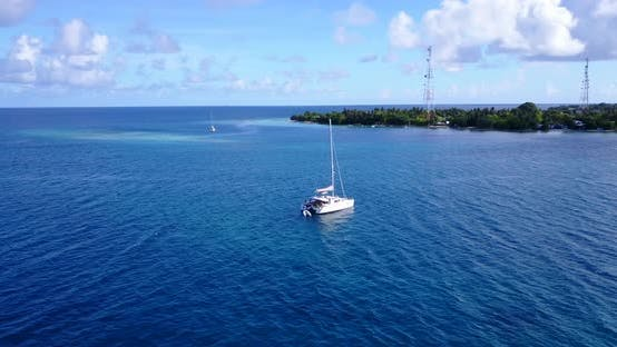 Thumbnail for Daytime aerial island view of a sunshine white sandy paradise beach and blue ocean background in hi
