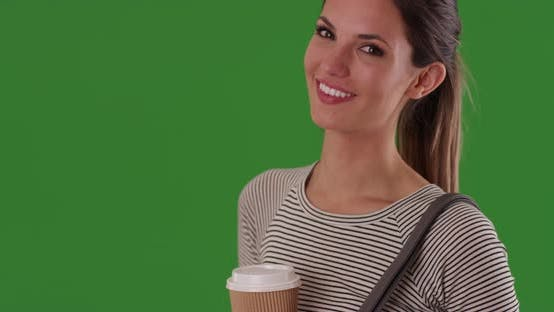 Thumbnail for Portrait of happy smiling millennial woman holding coffee to go on greenscreen